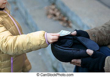 Somebody gives money to the beggar.