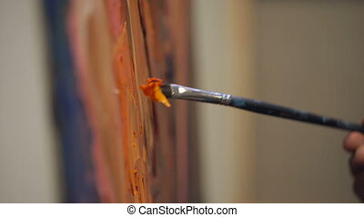 Somebody is painting some picture with paintbrush. Bold...