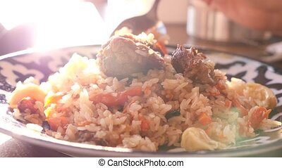 someone eats pilaf in a restaurant of national cuisine. 4k,...