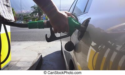 someone refueling car - person refueling car, scene on...