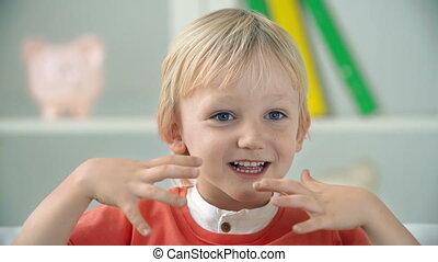 Close up of little boy laughing joyously