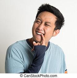Something stuck in teeth - Nasty Asian man portrait,...