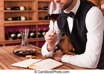 Sommelier examining wine. Cropped image of confident male ...