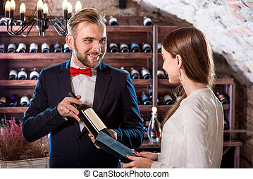 Sommelier in the wine cellar