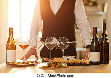 Sommelier - Mid section background of unrecognizable ...