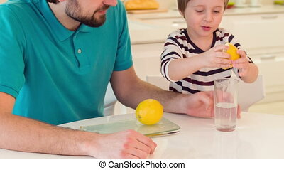 Son and dad playing with lemon