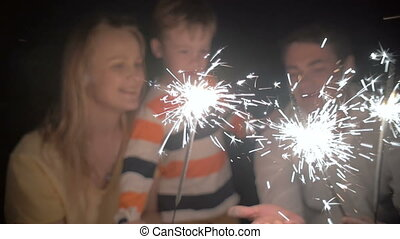 Son and His Parents Catching Sparkles of a Bengale Fire