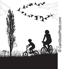Son and mother on bikes