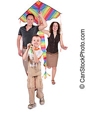 son and parents start kite