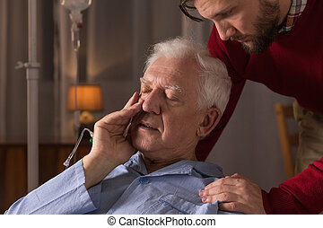 Son caring about father - Photo of son caring about father...