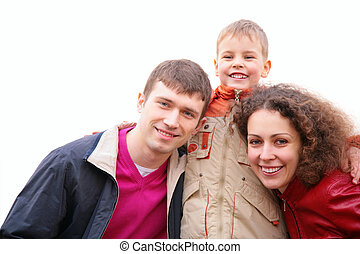 son embraces parents outdoor