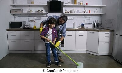 Son helping single father with domestic chores -...