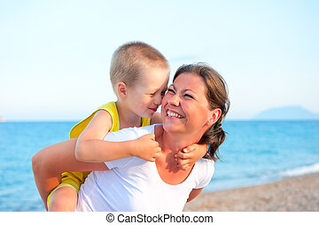 son hugging his mother on holiday
