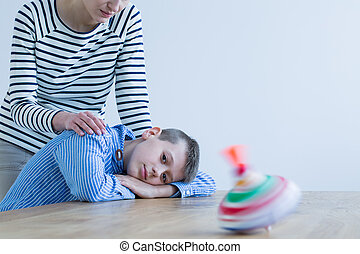 Son looking at colorful toy
