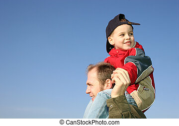 son on father shoulders
