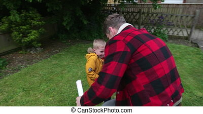 Son Playing Outside with his Father