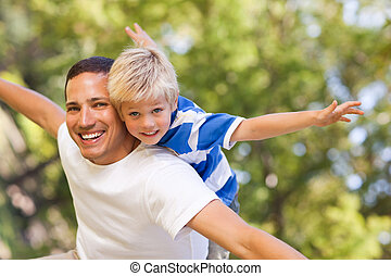 Son playing with his father in the