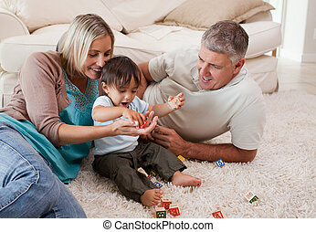 Son playing with his parents