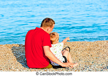 son reveals that his father is in the sea, they are sitting