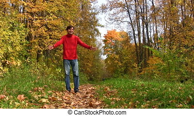 son running to father in autumnal park