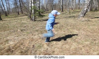 son runs to mother in spring forest