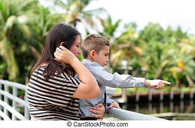 Son showing something to his mother