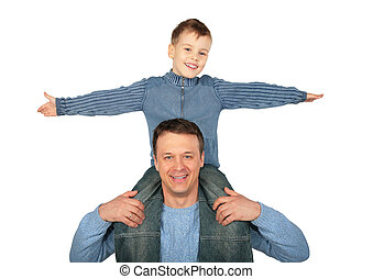 son sits on father`s shoulders