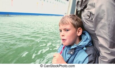 Son speaks with his mother when watch on huge cruiser