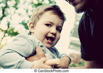 Son with father, happy moments together. Childhood, vintage