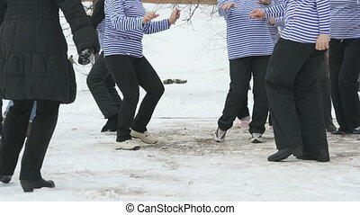 Song and dance team woman sailor in blue singlets in winter