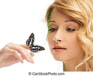 sonhar, mulher jovem, em, conceitual, primavera, traje, com, borboleta, ligado, dela, mão