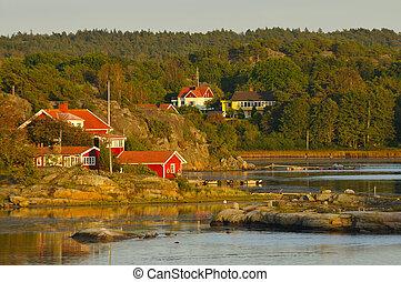 Schweden - Sonnenuntergang an einen Fjord in Schweden.