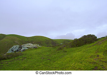 Sonoma Rolling hills with granite outcropping against a ...