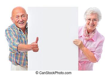 sonreír feliz, pareja mayor, con, un, blanco, tabla