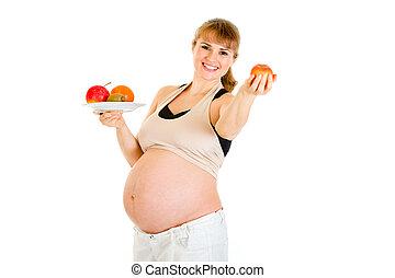 sonriente, hermoso, mujer embarazada, tenencia, fruits, en, manos, aislado, blanco