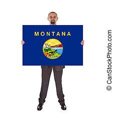 sonriente, hombre de negocios, tenencia, un, grande, tarjeta, bandera, de, montana