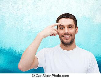 sonriente, joven, guapo, hombre señalar con el dedo, a,...