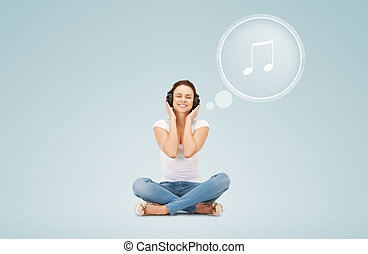 sonriente, mujer joven, o, adolescente niña, en, auriculares