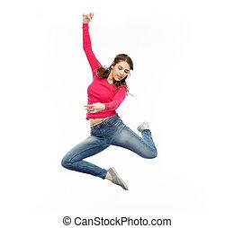 sonriente, mujer joven, saltar hacia dentro, aire