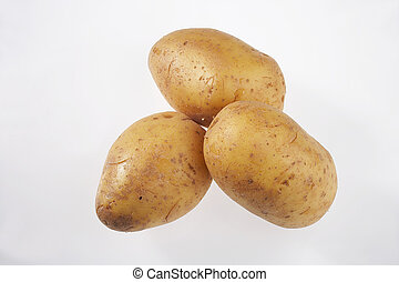 three potatoes on white background - drei Kartoffeln auf weissem Hintergrund