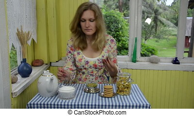 soothing calendula tea - girl in a bright room enjoying the...