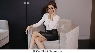 Sophisticated and Elegant Business Woman Sitting on...