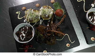 Sophisticated and tasty menu with lamb meat garnished with...