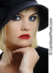 Beautiful woman poses for a portrait in her vintage hat