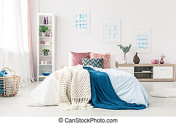 Sophisticated bedroom interior with posters