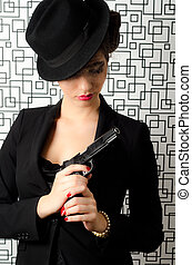 Sophisticated woman holding a gun in her hands
