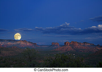 sopra, sorgere luna, rocce rosse