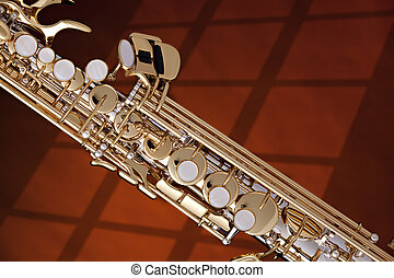 Soprano Saxophone Isolated against Gold