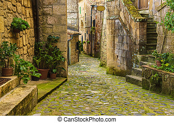 Sorano city street - Narrow street of medieval ancient tuff ...