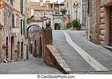 Sorano, Grosseto, Tuscany, Italy: picturesque corner with narrow alley, ancient houses and church in the Tuscan medieval village